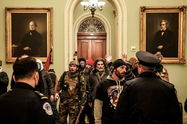 Robert Gieswein, left, in military garb, and Dominic Pezzola, center right, with a gray beard, confronted Capitol Police officers at the U.S. Capitol