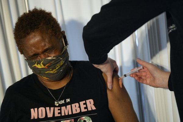 Yvonne Brazelton, 64, of St. Paul, winced as she received a dose of the Moderna COVID-19 vaccine Friday at a United Family Medicine clinic in St. Paul