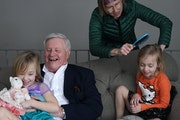 Collin Peterson tickled his granddaughter Astrid while her twin sister Ingrid got her hair brushed by her mom Michelle Thursday morning. ] ANTHONY SOU