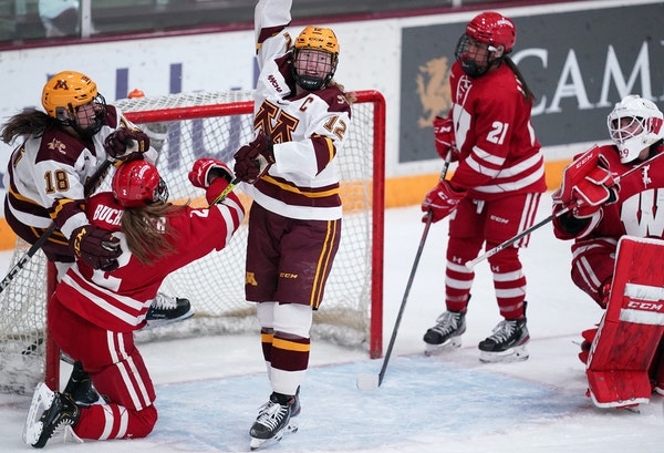 Gophers forward Grace Zumwinkle threw her arm up in celebration after she scored the game tying goal past Wisconsin goaltender Kennedy Blair (
