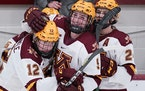 The Gophers' Grace Zumwinkle (12), Taylor Heise (9) and Olivia Knowles (24) get another crack at Wisconsin on Saturday in the WCHA semifinals.