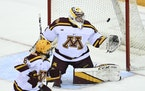 Wisconsin defenseman Ty Emberson scored a goal against Gophers goaltender Justen Close in the third period.