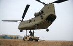 The St. Cloud-based unit flies CH-47 Chinook heavy-lift helicopters, which are capable of transporting personnel and equipment.  Credit: National Guar