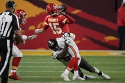 Chiefs quarterback Patrick Mahomes threw a pass while in the grasp of Buccaneers outside linebacker Shaquil Barrett during the second half of Super Bo