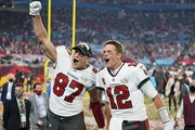Tampa Bay Buccaneers tight end Rob Gronkowski (87), left, and Tampa Bay Buccaneers quarterback Tom Brady (12) celebrate together after winning the Sup