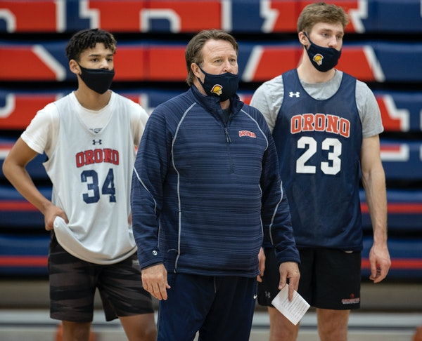 Orono basketball coach Barry Wohler with players Isaiah Hagen and Connor Chappell.