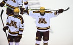 Minnesota defenseman Jackson LaCombe (2) and forward Nathan Burke (21) skated off the ice Saturday following their 8-1 loss against Wisconsin.