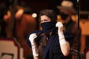 Alaina Sandau put her scarf back in place between dialogue segments of a scene in The 1940's Radio Hour. ]  JEFF WHEELER • jeff.wheeler@startribun