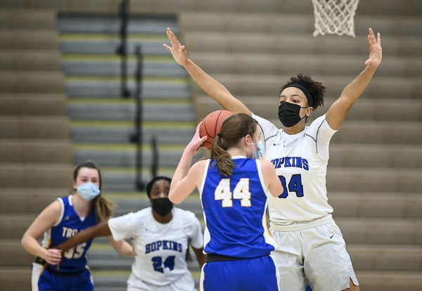 Hopkins forward Maya Nnaji (34) guarded Wayzata forward Shannon Fornshell (44) in a Jan. 19 game at Wayzata. Masks have been required since winter spo