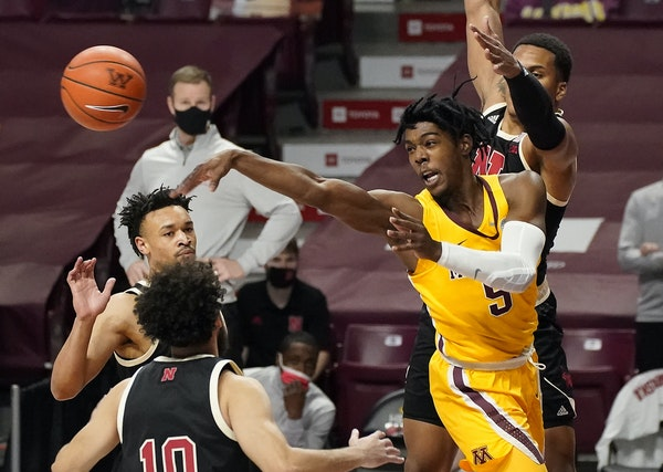 Gophers guard Marcus Carr passed the ball during the first half of Monday night's game against Nebraska.