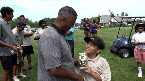 Darwin Dean handed the first-place trophy to Mateo Martinez, winner of the 2019 Junior Bronze tournament for 7- to 10-year-olds at Hiawatha Golf Club.