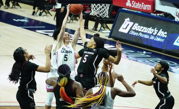 Connecticut guard Paige Bueckers (5) grabs a rebound in the second half against South Carolina.