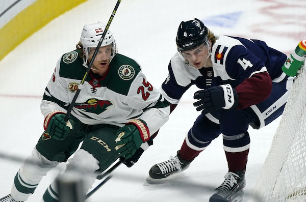 Wild defenseman Jonas Brodin, left, skated past Colorado's Bowen Byram during  a game in Denver on Feb. 2.  Because of COVID-19 outbreaks, neither t