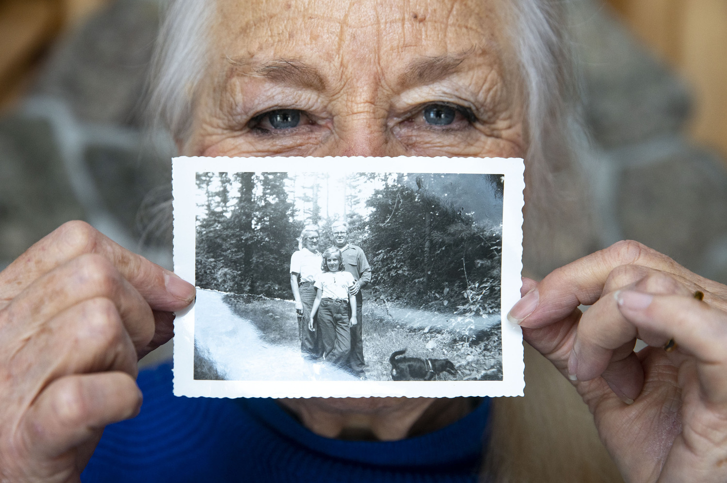 Joyce Leddy showed a picture of herself, top, as a young girl with her parents during a visit to the Gunflint region.