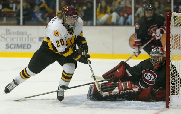 Minneapolis, MN. October 19, 2002. Gopher women's hockey vs. St. Cloud. Gophers #20 Natalie Darwitz  shoots and scores her first goal of the game ag