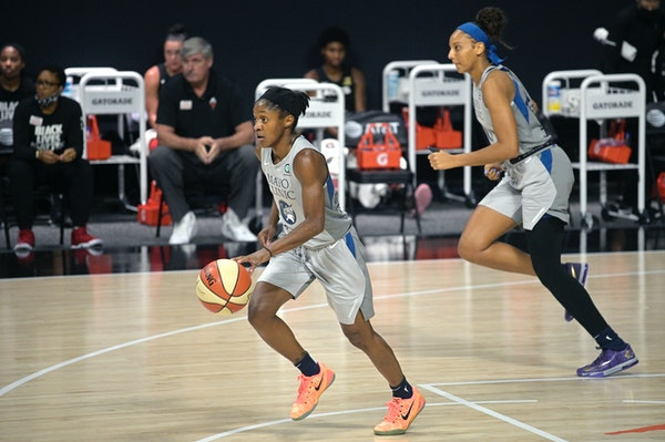 Lynx guard Crystal Dangerfield brings the ball up the court in front of forward Mikiah Herbert Harrigan, right,  during a game in Bradenton, Fla., on