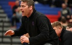 Simley coach Will Short watched his wrestlers compete in a match in 2017.