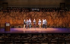 """Members of Cantus rehearse for the ' annual """"Cantus Idol"""" contest, in which the eight members of the group sing songs of various styles, a la """"Ame"""
