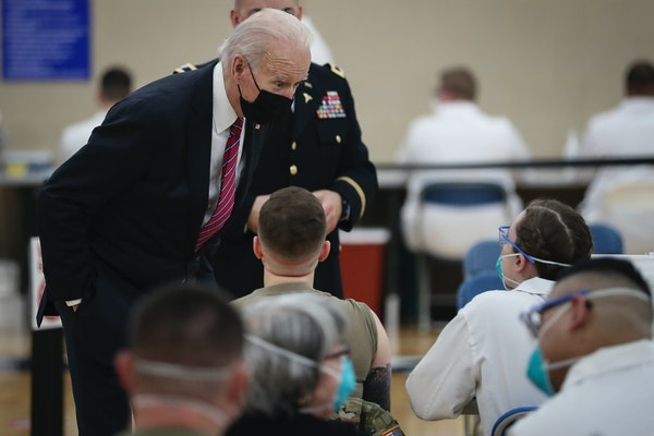 President Joe Biden visits a COVID-19 vaccine center at Walter Reed National Military Medical Center in Bethesda, Md., on Friday, Jan. 29, 2021.