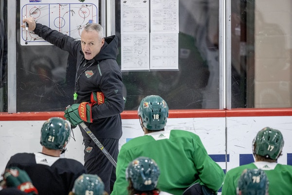 Wild coach Dean Evason instructed players during a January practice.
