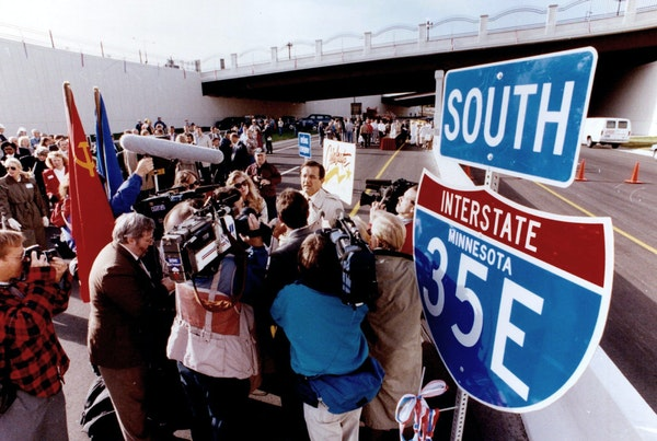 Gov. Rudy Perpich gathered with residents and officials during the opening of I-35E near downtown St. Paul in October 1990.