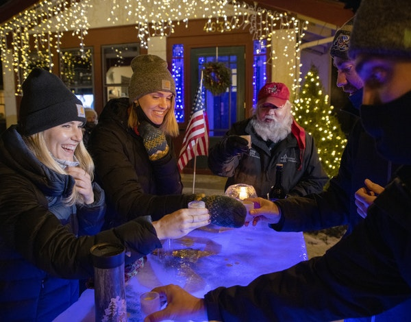 Lacey Olson, Laura Weber, Tom Vick, Christopher Vick and Jake (to come) toasted at an outdoor Ice bar at the home of ChristopherÕs parents Tom and He