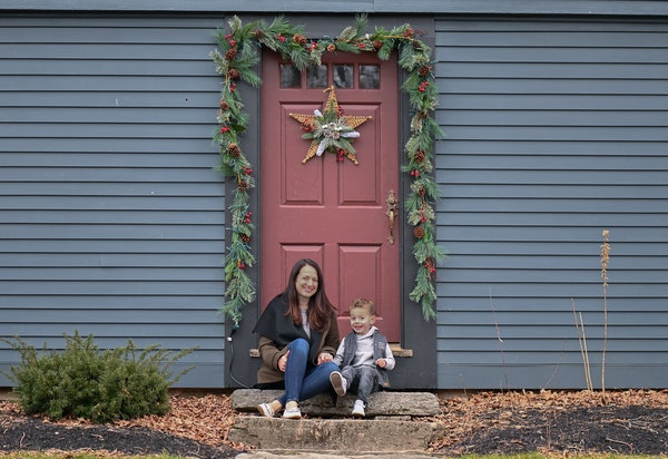 """Rebecca Lineberry Galko and her daughter in front of their new """"old"""" home in Higganum, Conn., Jan. 21, 2021. Instagram and fans of painstaking ren"""