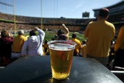 A beer sits atop a garbage can as Gopher fans cheer a long first quarter play against New Hampshire Saturday, Sept. 8, 2012, at TCF Bank Stadium. (DAV