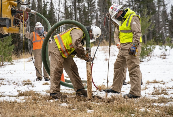 Enbridge utility contractors work to identify and mark an older Enbridge pipeline, Line 16, at one of the Line 3 work sites in Carlton. (ALEX KORMANN/