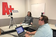 Michelle Allender and Jack Rudman of A+ Driving School in White Bear Lake conduct a driver's education class for high school students online.