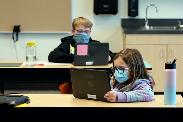 Students wore masks Feb. 2 as they worked in a fourth-grade classroom at Elk Ridge Elementary School in Buckley, Wash.