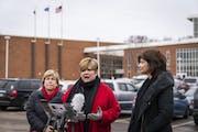 Denise Specht, center, president of Education Minnesota, spoke during the news conference, joined by Randi Weingarten, left, president of American Fed