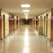 Empty School Hallway with Student Lockers Children who need school as a safe space will suffer during this pandemic.