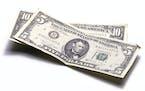 iStock5 dollar bill, 10 dollar bill.