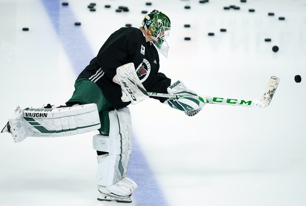 Wild goaltender Kaapo Kahkonen warmed up by launching pucks from the blue line as he waited on the ice for the team's resumption of practice Friday.