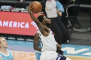 Timberwolves guard Malik Beasley drives to the basket against Charlotte