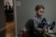 Elena Williams worked on some MCTC school work as her son, Parker, 4, played with a Star Wars toy in his room Wednesday night. ] AARON LAVINSKY • aa