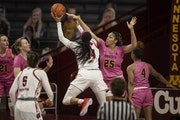 Gophers center Klarke Sconiers (25) forced Wisconsin Badgers forward Imani Lewis to miss a shot at William Arena on Sunday. The Gophers defeated Wisco