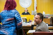 Public defender Adam Lipson spoke with a defendant appearing before JudgeBruceChaninYoungAdultCourt, inSanFrancisco, March 28, 2017. T
