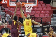 Gophers guard Jamal Mashburn Jr. had his shot rejected by Maryland forward Galin Smith during the first half Sunday.