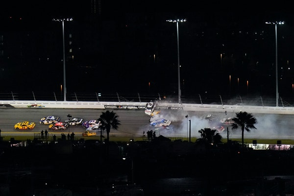 Racers crashed during the last lap in the Daytona 500 on Sunday, paving the way for Michael McDowell, left, to win the race.