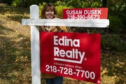 In tihis September 2020 file photo, Susan Dusek, a realtor for Edina Realty, posed for a portrait in front of a r house for sale in the Congdon Park n