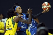 Odyssey Sims shot over Seattle's Natasha Howard during a game on Sept. 27 in Bradenton, Fla.