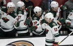 Wild center Nick Bonino (13, being congratulated by teammates after a goal against the Ducks in January) was one of three Wild players released from C
