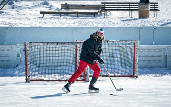 """""""Not bad at all"""" said Dan Larson after slapping pucks on Lake of the Isles Monday morning """"There is no wind at all, and this sunshine is great!�"""