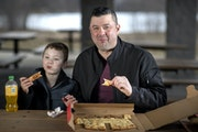 Scott Poepard and his son Kierson ate pepperoni pizza from Red's Savoy in St. Paul. Poepard has tried some 700 pizzas nationwide in the past 10 year