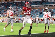 DeVonta Smith #6 of the Alabama Crimson Tide rushes for a 42 yard touchdown during the second quarter of the College Football Playoff National Champio