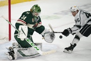 Los Angeles Kings center Blake Lizotte (46) stabbed at a rebound in the second period off Minnesota Wild goaltender Kaapo Kahkonen (34).