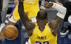 LeBron James of the Lakers dunked the ball in the first quarter Tuesday night at Target Center.