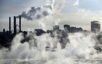 Water vapor rises above St. Anthony Falls on the Mississippi River as the Stone Arch Bridge is obscured, on Jan. 29, 2019, in Minneapolis.